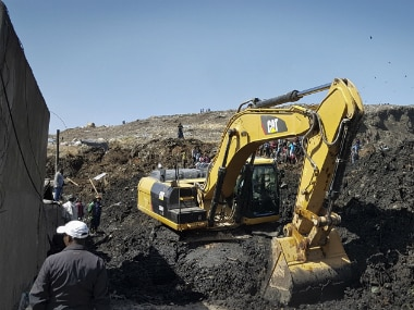 An excavator aids rescue efforts at the scene of a garbage landslide on the outskirts of the capital Addis Ababa, Ethiopia. AP
