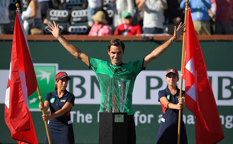 Roger Federe poses with a record-equalling fifth Indian Wells trophy after his win against Stanislas Wawrinka on Sunday. AP