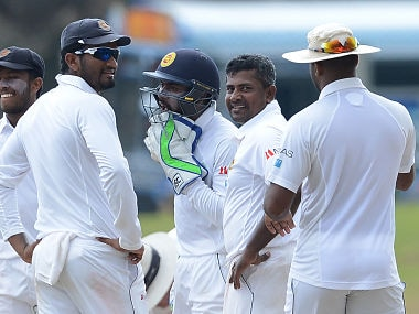 Rangan Herath (2R) celebrates with teammates after taking Mushfiqur Rahim's wicket. AFP