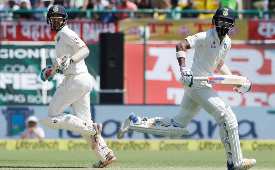 India's Lokesh Rahul and Cheteshwar Pujara run between the wickets during the second day of their fourth Test against Australia in Dharmsala. AP