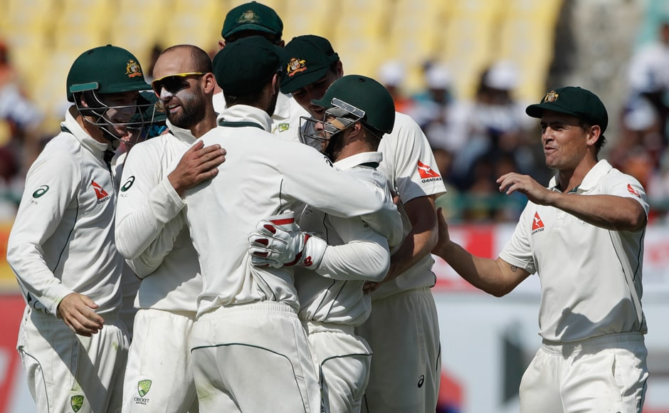 Australia's spinner Nathan Lyon and his teammates celebrate as Karun Nair walked back to the pavilion cheaply during the second day of the final Test. AP