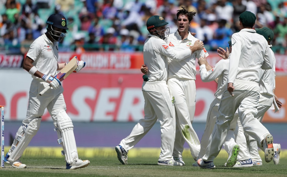 Pacer Pat Cummins was pumped-up as he celebrates with teammates after getting the best out of India's Lokesh Rahul during the second day of their fourth test cricket match in Dharamsala. AP