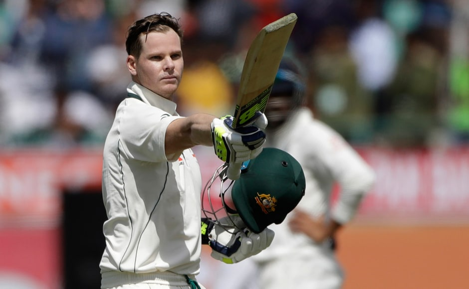Australia started their first innings brilliantly as skipper Steve Smith raises his bat and celebrates his third century on the first day of the fourth Test. AP