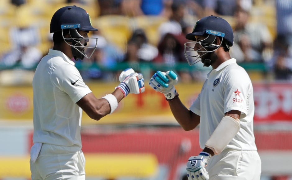 KL Rahul and Cheteshwar Pujara cheer each other after maintaining a good partnership in the first innings of the second day against Australia in Dharmsala. AP