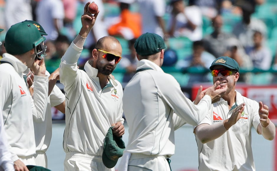 Australia's Nathan Lyon raises the red cherry after raking up a five-wicket haul on the third day of the final Test. AP