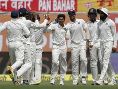 India's Kuldeep Yadav, center, and his teammates celebrate a wicket on Day 1. AP