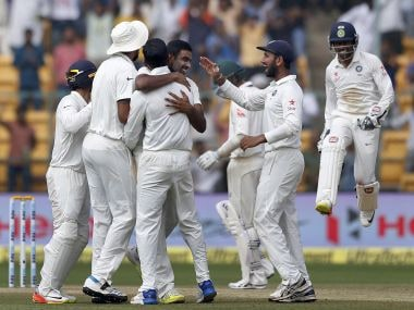India's Ravichandran Ashwin celebrates with teammates during the Bengaluru Test. AP