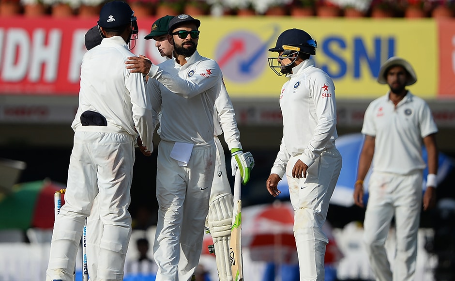 Indian team captain Virat Kohli greets teammates after the third Test between India and Australia ended in a draw at the Jharkhand State Cricket Association (JSCA) Stadium complex in Ranchi. AFP