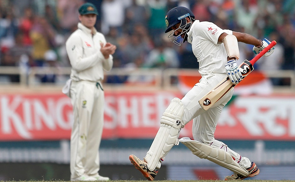 This was surely the highlight of the match! Australia's captain Steven Smith applauds as India's Cheteshwar Pujara celebrates scoring his second double hundred against Australia. AP