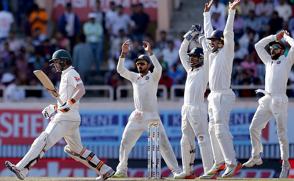 Australia were feeling the heat on the fifth day as India's captain Virat Kohli and teammates appeal unsuccessfully for the dismissal of Glenn Maxwell. AP