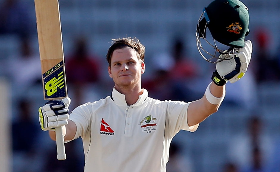 Australia's captain Steven Smith raises his bat and helmet to celebrate scoring a century during the first day of their third test cricket match against India in Ranchi. AP