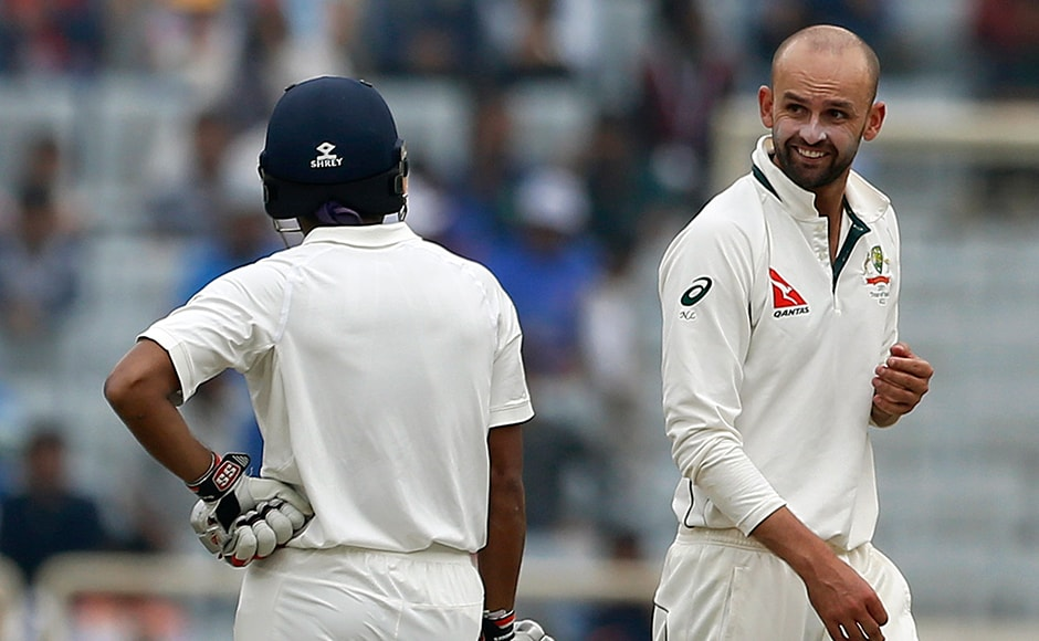 Yes, there was a bit of sledging too! Australia's Nathan Lyon gestures to India's in-form Wriddhiman Saha on the fourth day. AP