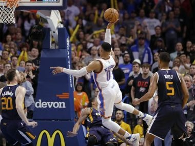 Oklahoma City Thunder guard Russell Westbrook goes up for a basket against Utah Jazz players. AP