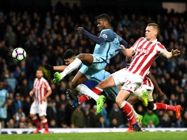Ryan Shawcross (right) of Stoke City pulls back Kelechi Iheanacho of Manchester City during their Premier League match on Wednesday. Getty Images