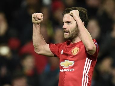 Manchester United's Juan Mata celebrates after scoring against Rostov. AFP