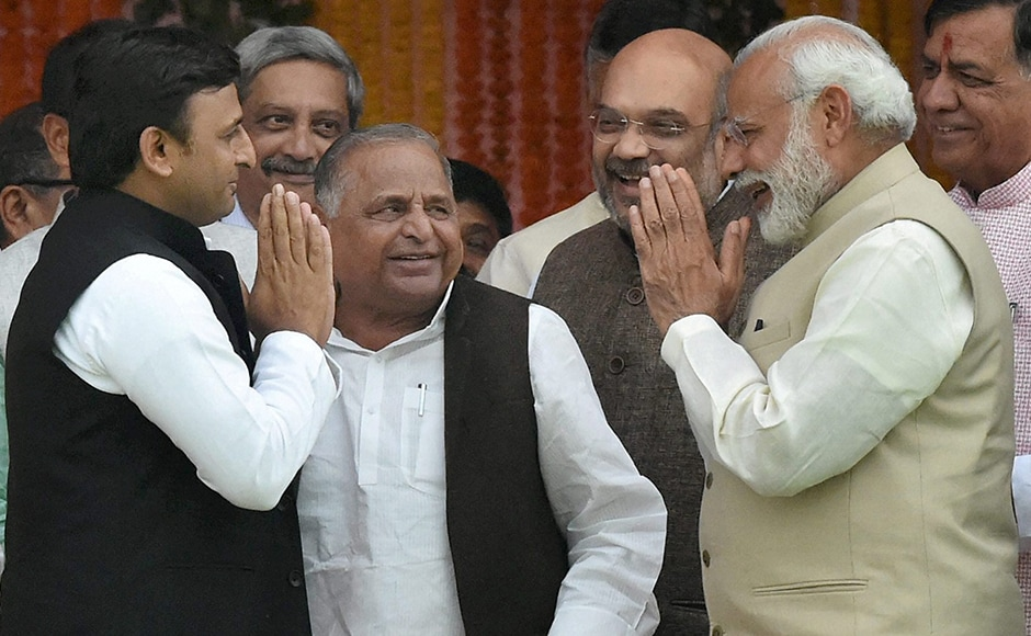 Mulayam Singh Yadav (centre) casting wistful glances towards Narendra Modi, wondering what more could he have done, much to the amusement of Amit Shah. PTI
