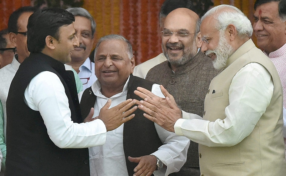 Akhilesh Yadav (left) and Narendra Modi (right) talking about how many seats their respective parties won. Only one man went back happy from this conversation. PTI