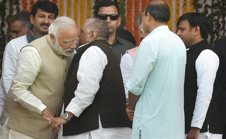 Mulayam Singh Yadav grabs Narendra Modi's hands in a vice-like grip, refusing to let go of this nice man who always wins elections.PTI