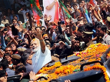 Prime Minister Narendra Modi waves to his supporters in Varanasi. PTI