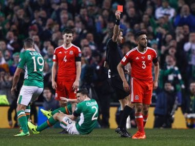 Neil Taylor was red carded for a bad foul on Seamus Coleman. AFP