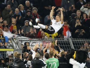 Lukas Podolski is thrown into the air by his Germany teammate after the friendly win over England. AP