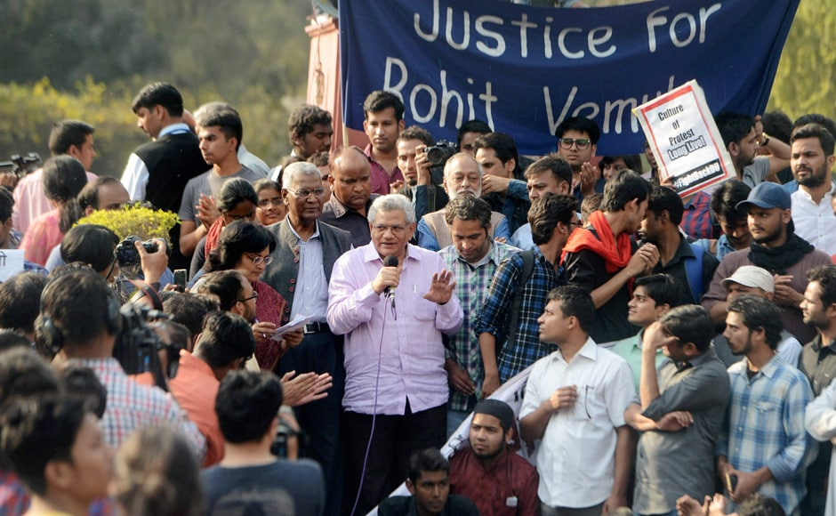 CPI-M General Secretary Sitaram Yechury and CPI-M's D Raja address students during their protest march against ABVP at North Campus in New Delhi on Tuesday. PTI
