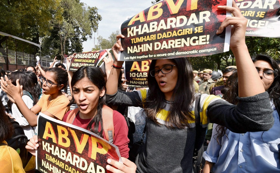 """Students and teachers of Delhi University, JNU and Jamia during their protest march against ABVP at North Campus in New Delhi on Tuesday. The students held placards with messages like """"Save the varsities from the onslaught of ABVP"""" and """"Your nationalism is not above our democracy"""". PTI"""