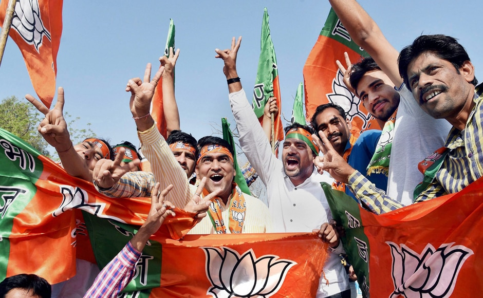 Supporters of BJP celebrate as early trends show the party's thumping win in the UP Election Results assembly polls, in Bikaner on Saturday. PTI