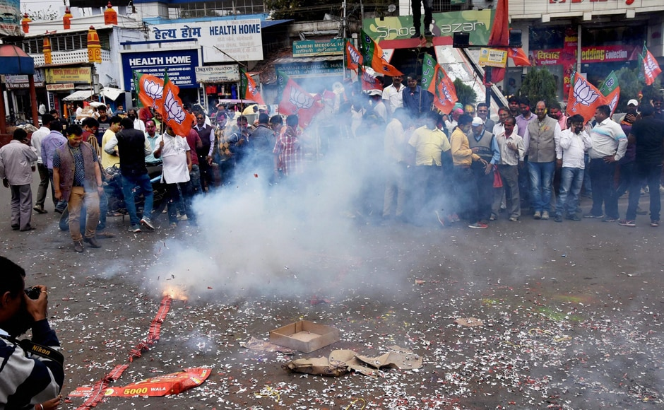 Supporters of BJP burst crackers in Ranchi on Saturday. PTI