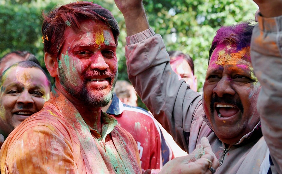 New Delhi: Former BCCI President and BJP MP Anurag Thakur playing holi with his supporters on the occasion of ' Holi festival' celebration in New Delhi on Monday. PTI