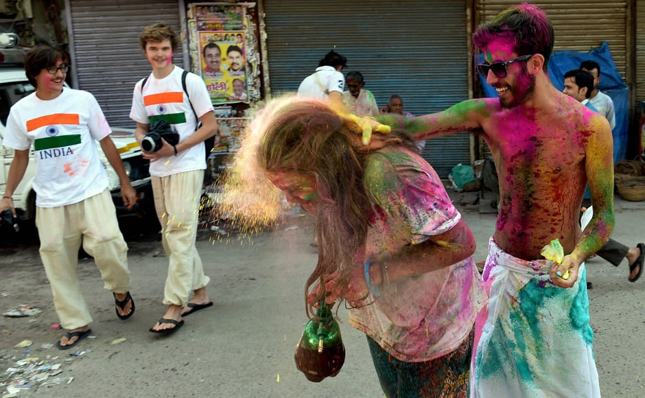 Holi is a community celebration. People are seen here enjoying the colours of the day. PTI