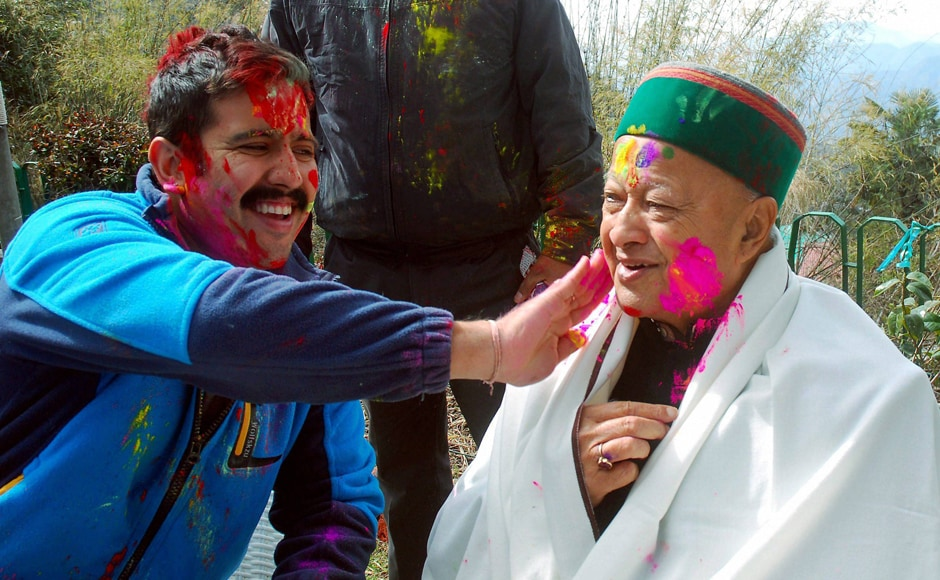 Shimla : Himachal Pradesh Chief Minister Virbhadra Singh celebrating Holi festival with his son in Shimla on Monday. PTI