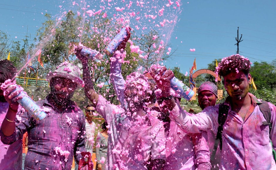 Youths celebrating Holi festival in Lucknow on Monday. PTI