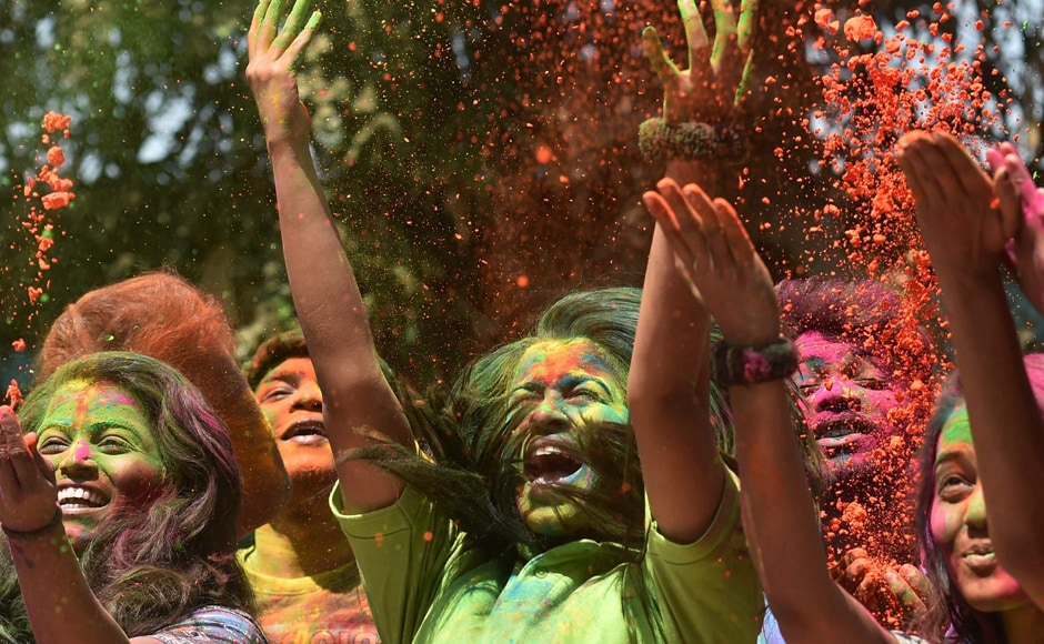 Young girls jubilate with colours during Holi celebrations at Shivaji Park area in Mumbai on Monday. PTI