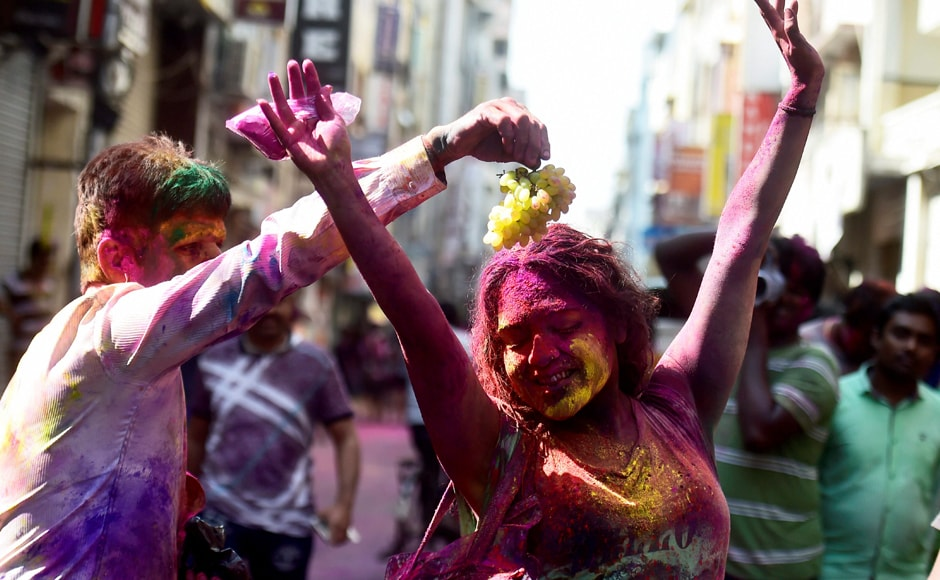 People enjoying with colours during Holi celebrations at Sowcarpet area in Chennai on Monday. PTI