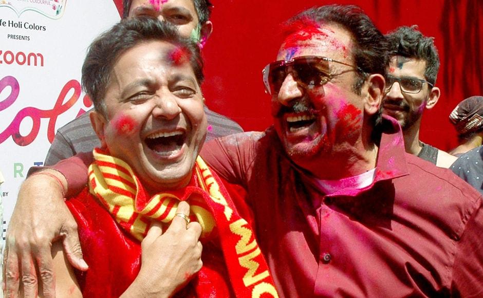 Gulshan Grover and singer Sukhwinder Singh celebrate Holi. PTI Photo