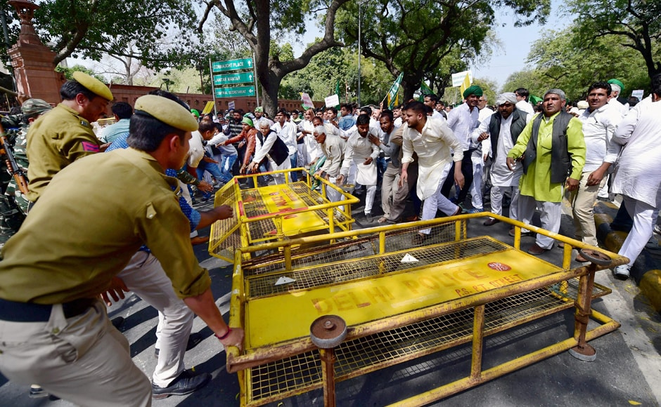 As the gathering approached near Parliament from Sansad Marg around 1.45 pm, police personnel rushed and erected the barricades on the road in front of Parliament Annexe. PTI