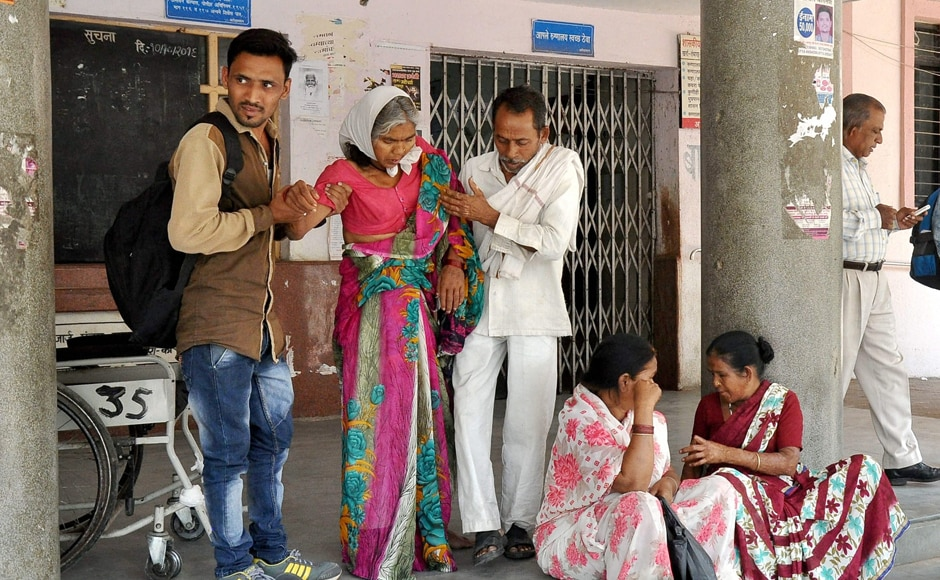 Patients wait outside the OPD at GMC hospital as resident doctors were on a strike in Nagpur on Friday. PTI Photo (PTI3_24_2017_000206B)