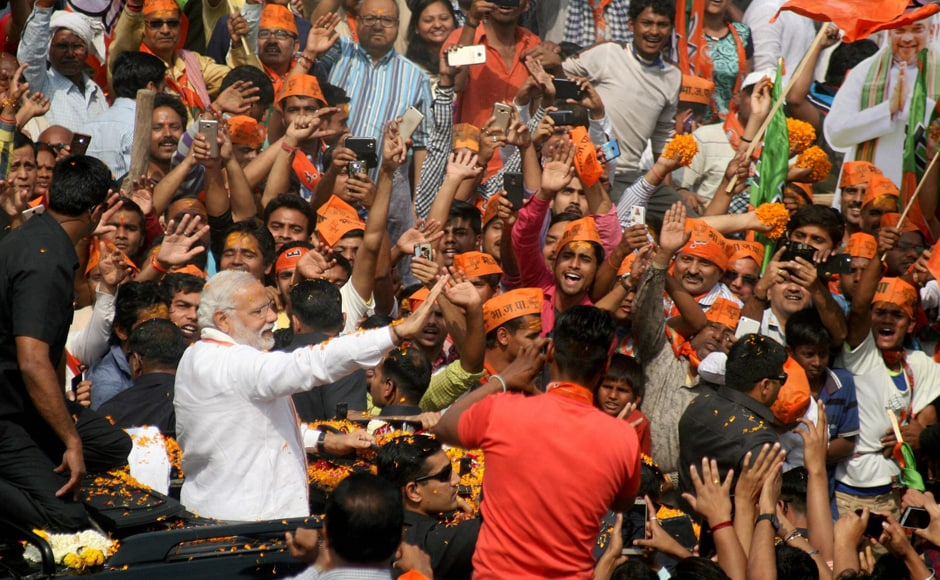 Slogans like Subah Banaras, sham Banaras; Modi tere naam Banaras and 'Modi, Modi' greeted the Prime Minister as he waved from an open top vehicle covered with marigold. PTI
