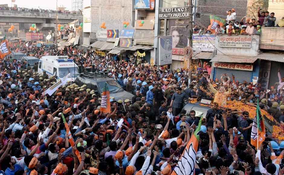 Thousands of supporters thronged the route along which Modi's cavalcade went. Carrying BJP flags and shouting 'Jai Shri Ram' and 'Har Har Modi, Ghar Ghar Modi', they waved at the prime minister, who acknowledged their greetings and waved back at them. PTI
