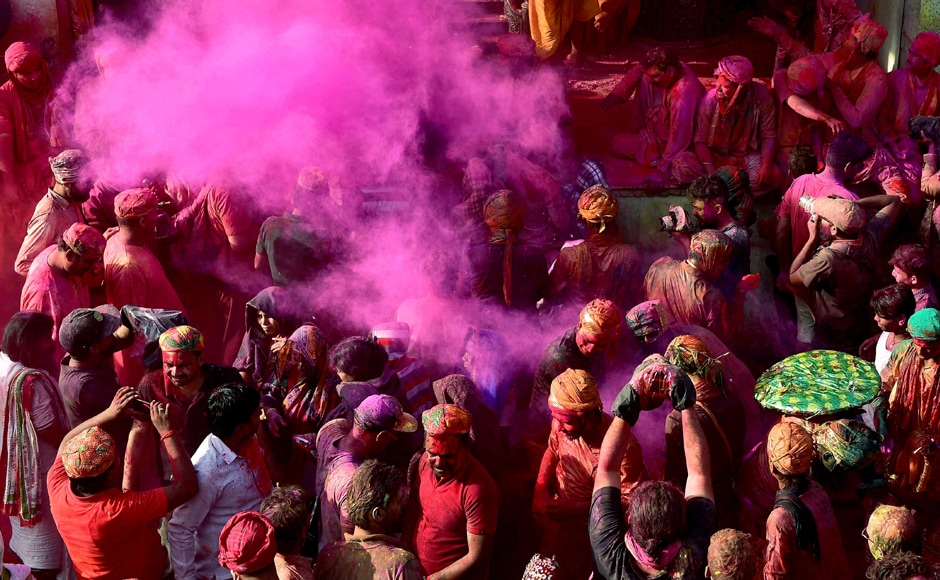 The traditional 'Lathamar Holi' started with pomp at Barsana village, as couples celebrated the colourful festival with utmost zeal amid a tight security put in place by district authorities. PTI