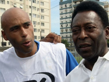 File photo of Pele and Edinho. AFP
