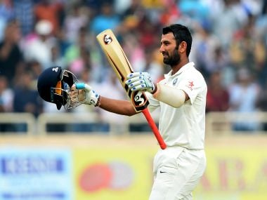 India's Cheteshwar Pujara celebrates after completing a double century. AFP