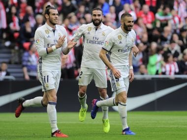 Real Madrid's Karim Benzema (right) celebrates his goal with teammates. AFP