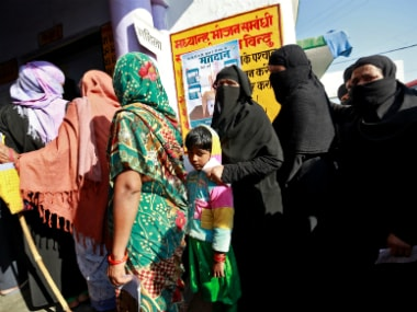 Women queue up to vote during the state Assembly election in the Uttar Pradesh. Reuters