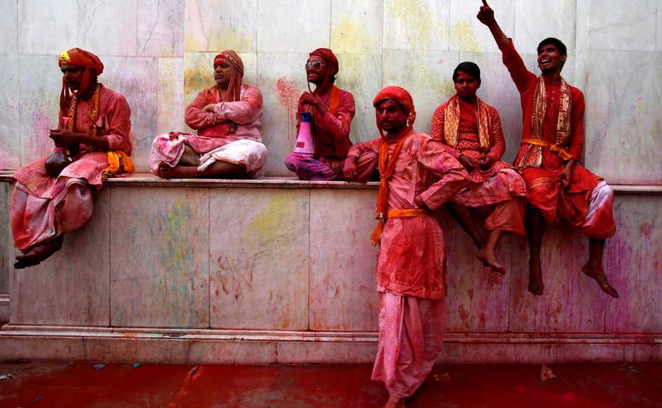 Hindu devotees take part in the religious festival of Holi in Nandgaon village. Reuters
