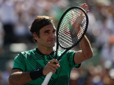 Roger Federer acknowledges his fans at the Miami Open. Getty Images