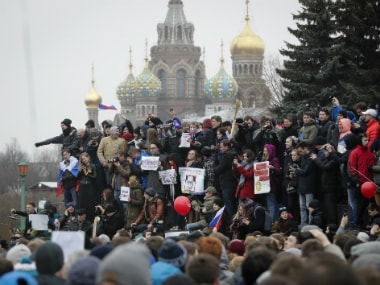 Protesters gather at Marsivo Field in St Petersburg, Russia on 26 March. AP