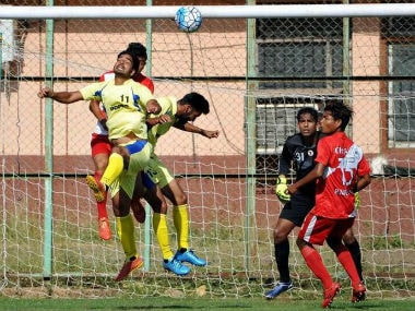 Punjab and Railways players in action at the 71st Santosh Trophy. PTI