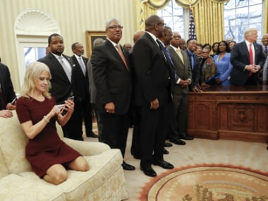 White House advisor Kellaney Conway appears on the couch Monday with her shoes on. AP